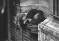 Man in niche, outside Spitalfields Crypt, 1970s